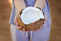 Open coconut in hands Stock Photo