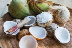 Open coconut with coconut peel. On bamboo mat Stock Images