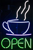Open Coffee Sign. Neon open sign in coffee shop window Stock Photo