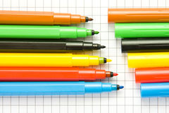 Open color markers. On notepad Royalty Free Stock Images