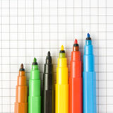 Open color markers. On notepad Royalty Free Stock Photo