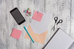 Open colored envelope blank sheet paper sticky notes ballpoint clips notepad scissors smartphone lying retro vintage royalty free stock photos
