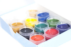 Open colorful cans of gouache paint in box Royalty Free Stock Image
