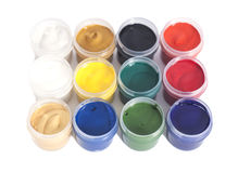 Open colorful cans of gouache paint Stock Photo