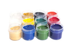 Open colorful cans of gouache paint Royalty Free Stock Images