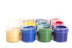 Open colorful cans of gouache paint Stock Images