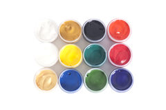 Open colorful cans of gouache paint Stock Photography