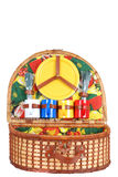 Open colorful picnic basket with utensils Stock Images