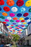 Open colorful umbrellas hang over street in Antalya, Turkey Royalty Free Stock Photography