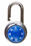 Open combination lock with blue dial. A combination pad lock that is open and has a blue dial and index mark Royalty Free Stock Photo