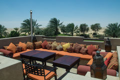 Open comfortable restaurant lounge with tables, sofas and pillows. Open  comfortable restaurant lounge with tables, sofas and pillows in desert resort Stock Photography