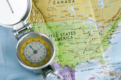Open compass on a map. Open compass on map of America Stock Image