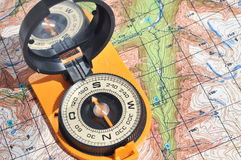 Open compass on the maps. Stock Photo