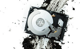 Open computer hard disk drive on muddy background Royalty Free Stock Images