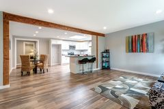 Open concept home interior with hardwood floor. Open concept home interior with hardwood floor and lots of space royalty free stock image