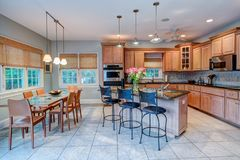 Open concept kitchen and dining room with windows royalty free stock photography