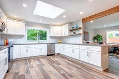 Free Open Concept Kitchen Equipped With Skylight. Stock Photography - 122124532