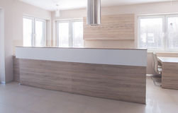 Open-concept kitchen with high worktop. High worktop that separates kitchen from the living room stock photos