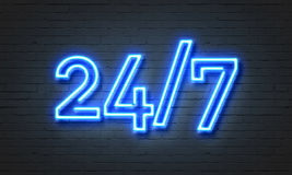 24/7 open concept neon sign. 24/7 open concept on brick wall background Stock Photography
