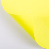 Open conner of yellow paper Stock Images
