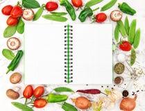 Open cookbook fresh organic vegetables Healthy food detox diet. Open cookbook and fresh organic vegetables. Healthy food, detox, clean eating, diet, vegetarian Royalty Free Stock Photos