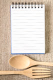 Open cookbook and kitchenware Royalty Free Stock Images