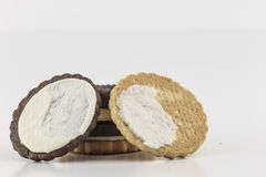 Open Cookie. Creme filled cookie twisted in half Royalty Free Stock Photography