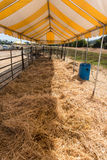 Open corral covering hay on the ground Royalty Free Stock Photos