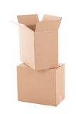 Open corrugated cardboard boxes ready for moving day over white Royalty Free Stock Photos