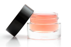 Open cosmetic jar. Open jar of cosmetic product isolated on white stock image