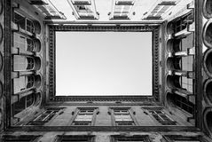 Open courtyard in Budapest. Architectural detail of an open courtyard in an ild building in Budapest, Hungary. Toned Stock Images