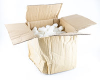 Open Crumpled brown box with white foam shockproof inside isolat Stock Photos