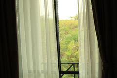 Open curtain of bedroom window Stock Photography