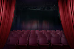 Open curtain theater before showtime. Empty auditorium with seats Royalty Free Stock Photo
