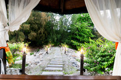 Open curtains leading to jungle path Stock Images