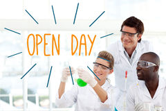 Open day against scientists working in laboratory Royalty Free Stock Photography