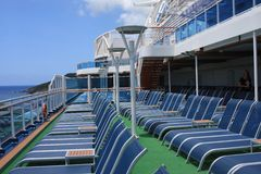 Open Deck on the cruise ship. Empty lounge chairs on the open deck on the cruise ship Royalty Free Stock Images