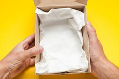 Open delivery box, courier shipping. Empty label, copy space for text royalty free stock image