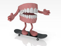 Open denture with arms and legs on skateboard Stock Image