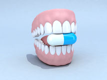 Open denture with pill Stock Photos