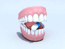 Open denture with pill Royalty Free Stock Images