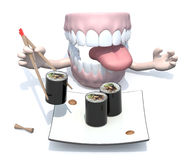 Open denture and sushi plate Royalty Free Stock Image