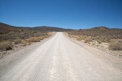 Open and deserted gravel road Royalty Free Stock Images