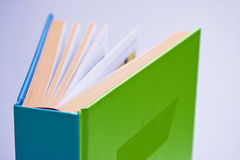 Open design book. On white background stock images