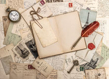 Open diary book, old accessories and postcards. Vintage background royalty free stock photos