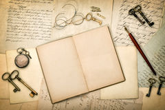 Open diary book, old letters and postcards. Paper texture Royalty Free Stock Images