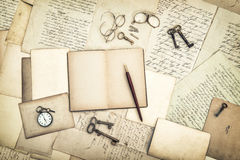 Open diary book, vintage accessories, old letters and postcards Royalty Free Stock Photos
