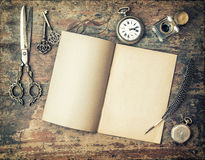 Open diary book and vintage writing tools feather pen Stock Photos