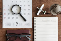 Open diary and calendar with passport Royalty Free Stock Images