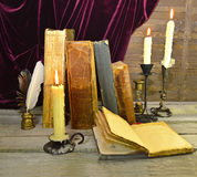 Open diary with candles and books Stock Photo